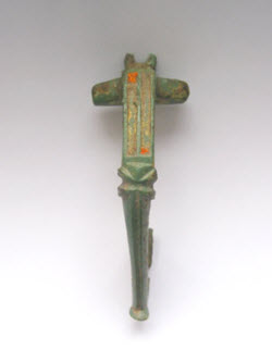An enamelled 'developed' T-shaped copper alloy brooch dating to the first/second century AD.